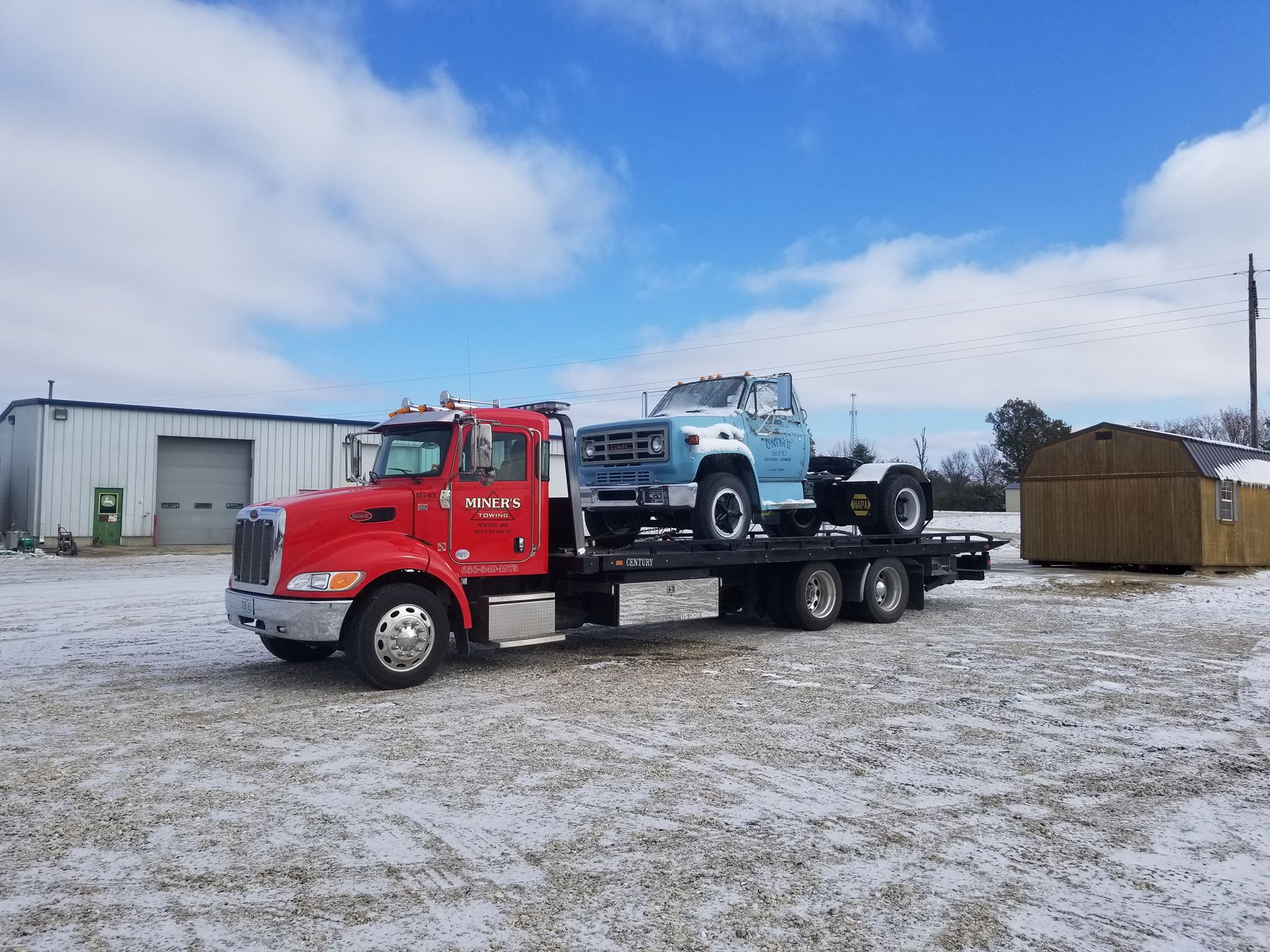 Rollback With Blue Truck
